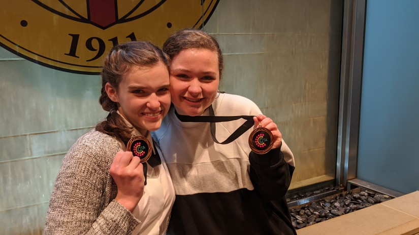 "Kinsey and Annalee with their Bronze medal for ""Little Women"""